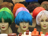 A colorful display of wigs and hair care products at the Albert Cuyp market.