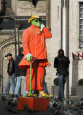 "This street performer at Dam Square assumes the Jim Carry character from the movie ""The Mask""."