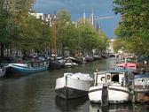 Canal boats serve as homes for many of Amsterdam's residents.