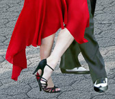 A close up of a tango step performed  by Mirabel and Julio.