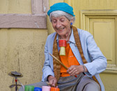 This senior street performer continues to find joy in her work.
