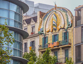 Gaudi influence contrasts with the more modern building across the street.