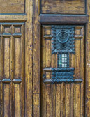 Weathered wood and handcrafted iron work make for an interesting door.