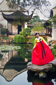 The bride poses at the Master of the Nets Dragon Gardens built over 800 yrs. ago.