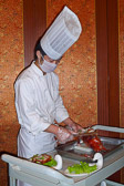 A hotel chef prepares our dinner in our group's private dining room.