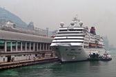 Cruise ships wait at the dock while passengers go Hong Kong shopping.