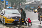 She makes an easy crossing before Beijing rush hour traffic begins.
