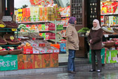 An early morning chat before customers arrive in Xian's Muslim Quarter.