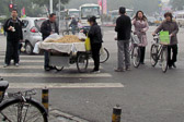 Vendors set up right in the middle of busy Beijing streets.