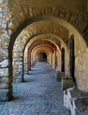 Walking through the arches at the Fortress Salses near Leucate.