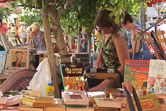 Browsing for books at the bi-weekly market in old Leucate.