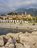 A beautiful beach with the Alpes Maritimes mountains as a backdrop.