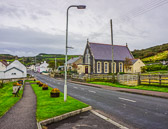 It's on the main road as you pass through a small village just outside of Bushmills.