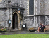 Two tired tourists take a break outside Dublin's Christ Church Cathedral.