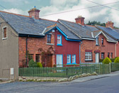 Attached houses with a backyard and common back alleys with garages are typical of middle class housing in Ireland.