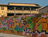 The plywood walls around a Fiosole construction site is a show place for the grafitti artists.