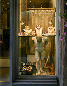 Many stores in today's Florence use past history to inspire their window displays.