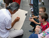 The sidewalk artist is one of many who depend on the tourists to earn their living.