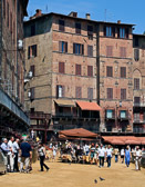 The piazza is  famous as the site of the Palio horse races during the summer in Siena.