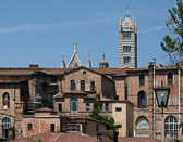 Another one of Siena's cathedrals provides a back drop to a view of the city's back side.