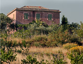 A rustic country home seen as we head out into the Tuscan country side.