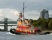 The tug is heading downtown towards the lower tip of Manhattan.