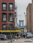 The Manhattan Bridge to Brooklyn viewed from a Chinatown street corner.