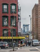 The Manhattan Bridge to Brooklyn viewed from a Chinatown street corner.