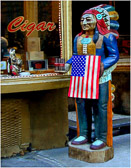 A cigar store indian in  Little Italy holds the American flag after 9/11.