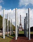 The pillars in the Parc Champ-de-Mars spell out peace in 32 languages.