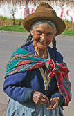 An old woman happily greets both us and the day early in the morning in Yucay.