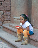 She's deep in thought while eating watermelon in the village of Yucay.