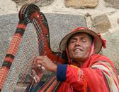 This blind harpist at the Sacred Valley plays music for the gods.