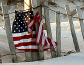 A tattered flag on a desolate New Jersey fisherman's beach a month after 9/11.
