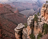 A person feels very insignicant staring into the vastness of the Grand Canyon.