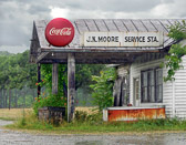 An abandoned gas station in a population shrinking southern town.