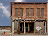 An abandoned building reminds us of the ecay of many American cities.